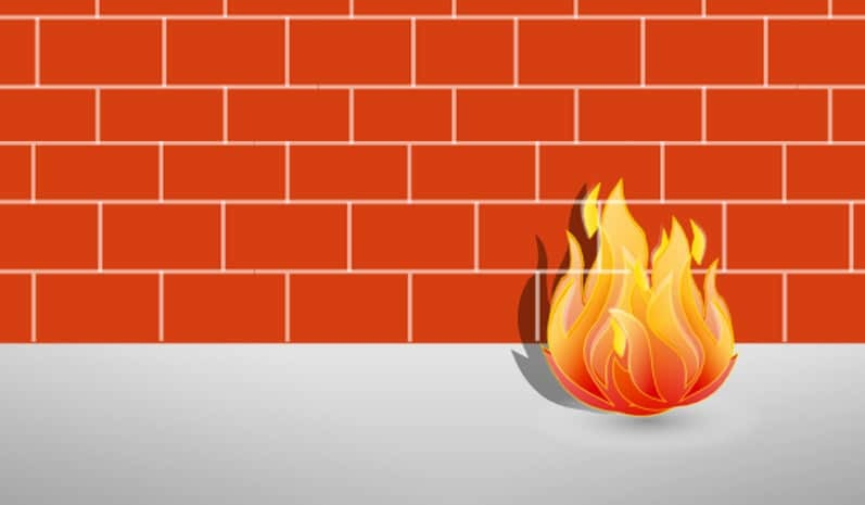 Old fashioned firewall representation of a fire in front of a red brick wall